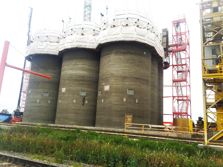 Dauphin concrete silos inner stice bins shipping grain cleaning Agribusiness Silos Stice bins Interstice bins Grain cleaning terminal construction Design-build Slipform concrete Concrete silos